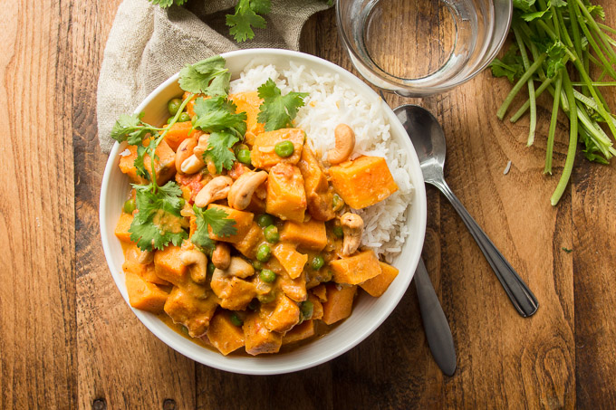 Bowl of Sweet Potato Curry with Rice and Cilantro