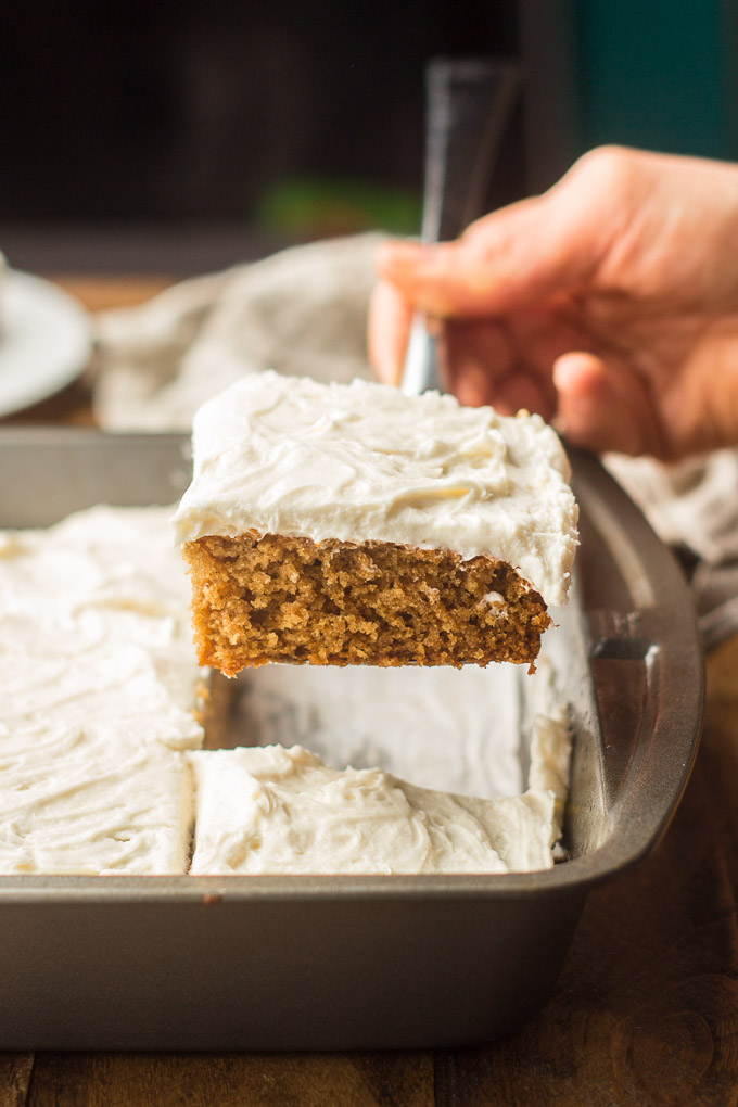 Hand Using a Cake Server to Remove a Slice of Vegan Spice Cake from a Pan