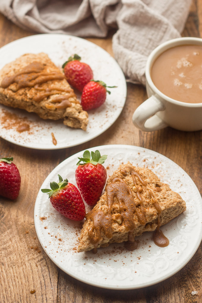 Two Vegan Brown Sugar Walnut Scones on Plates with Strawberries