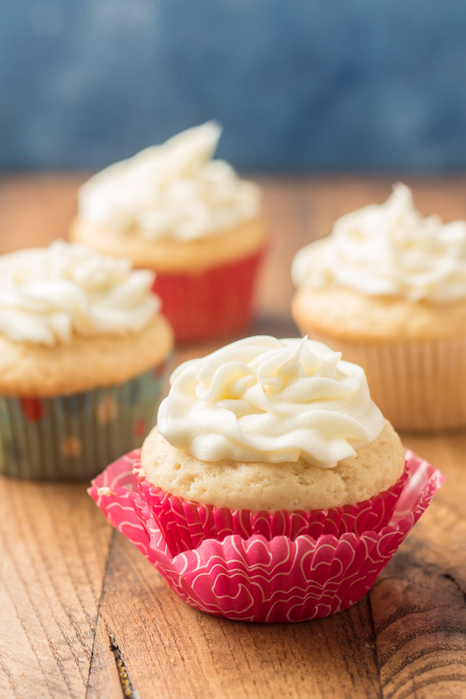 Four Vegan Vanilla Cupcakes Topped with Vegan Vanilla Frosting