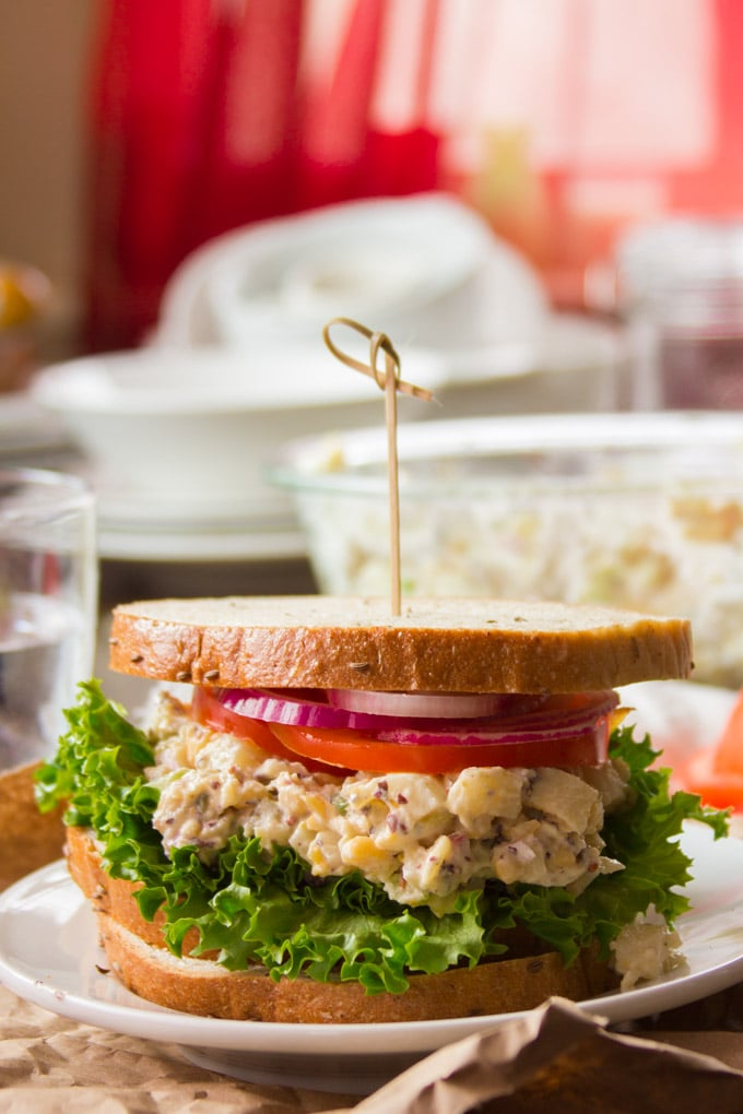 Vegan Tuna Salad Sandwich on a Plate with Dishes in the Background