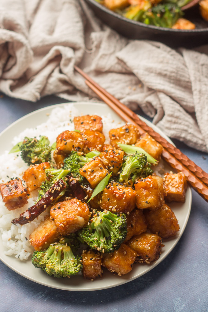 Plate of General Tso's Tofu with Chopsticks Perched on the Edge