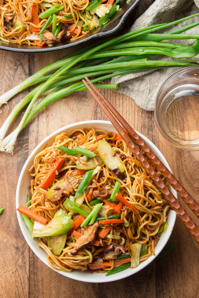Bowl of Vegan Vegetable Chow Mein with Chopsticks Resting on Top