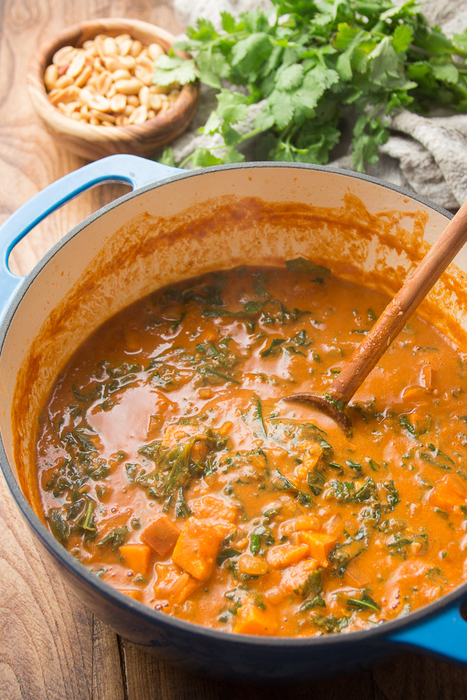 Pot of African Peanut Soup with Wooden Spoon