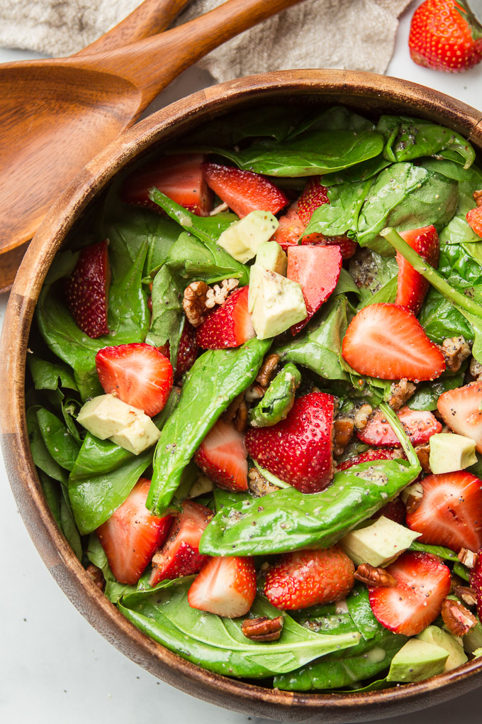 Close Up of Strawberry Spinach Salad in a Wooden Bowl