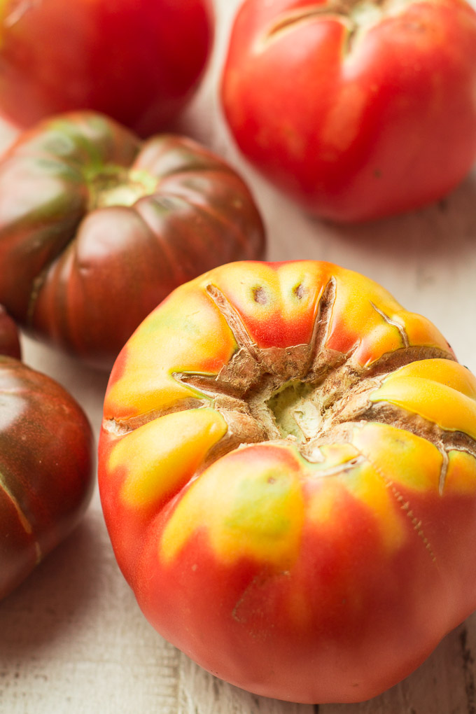 Colorful Tomatoes on a White Wooden Surface