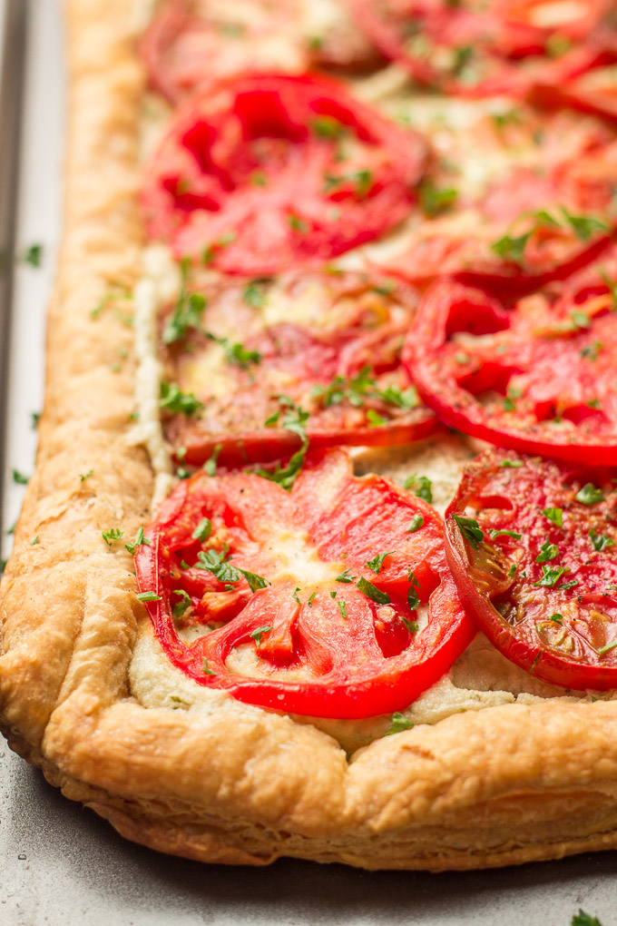 Tomato Tart Topped with Fresh Parsley on a Baking Sheet