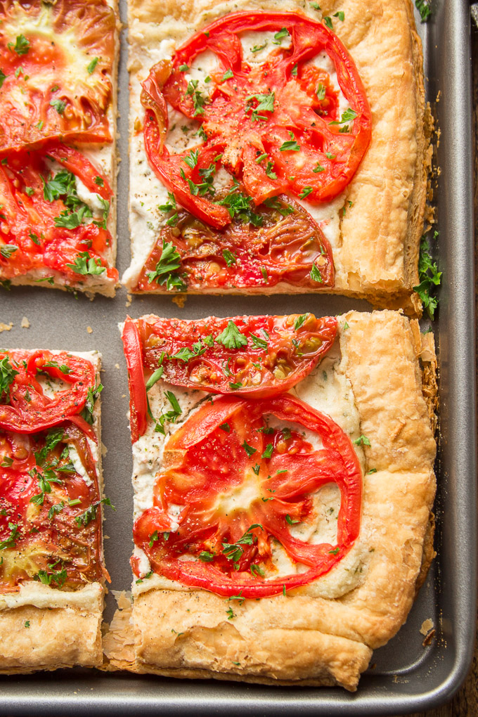 Four Slices of Tomato Tart on a Baking Sheet
