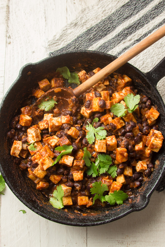 Cast Iron Skillet Filled with Tofu and Black Bean Burrito Bowl Filling