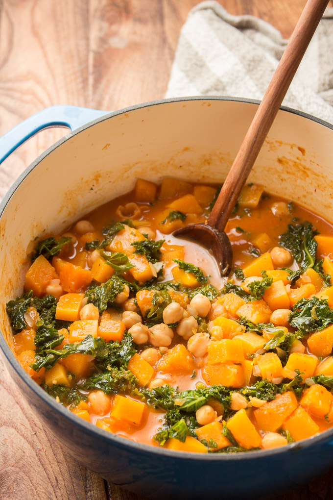 Butternut Squash Curry in a Pot with Wooden Spoon