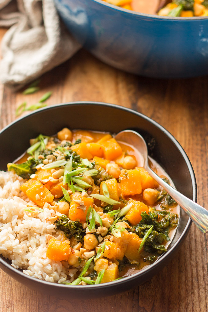 Bowl of Butternut Squash Curry with Blue Pot in the Background