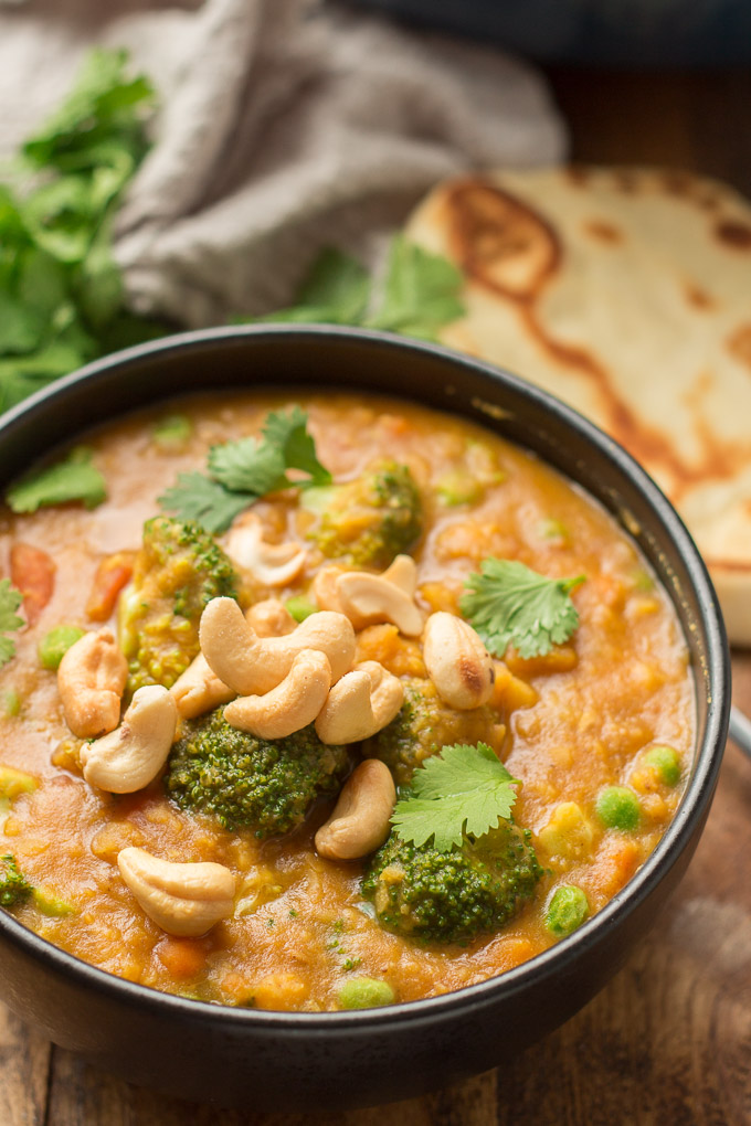 Close Up of Mulligatawny Soup Topped with Cashews and Cilantro