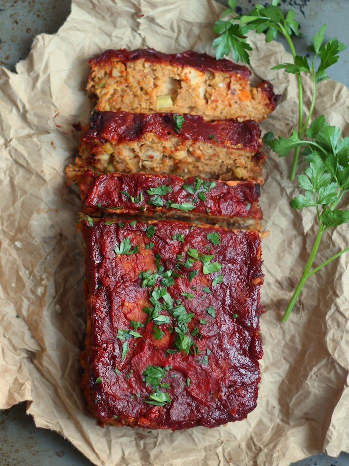 Sliced Vegan Chickpea Meatloaf Topped with Fresh Parsley