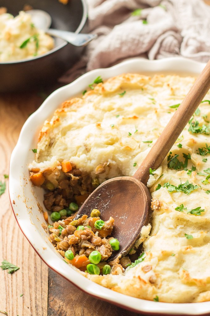 Close Up of a Wooden Spoon Digging into a Vegan Shepherd's Pie