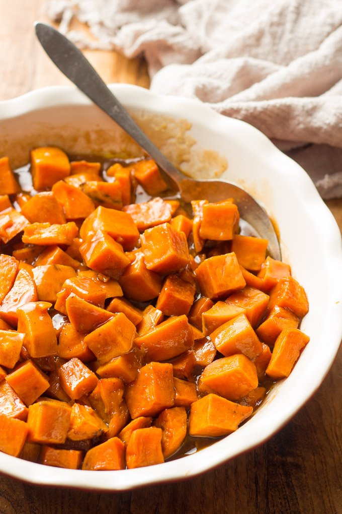 Close Up of Vegan Candied Yams in a Dish with Serving Spoon