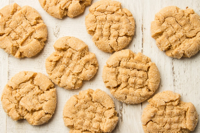 Vegan Peanut Butter Cookies Arranged on a White Wooden Surface