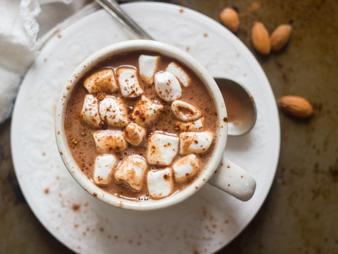 Overhead View of a Cup of Vegan Hot Chocolate with Marshmallows and Spoon