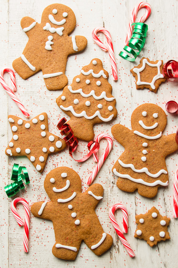 Vegan Gingerbread Cookies, Candy Canes and Ribbons on a Wooden Surface