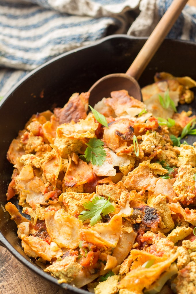 Close Up of Vegan Migas in a Skillet with Wooden Spoon